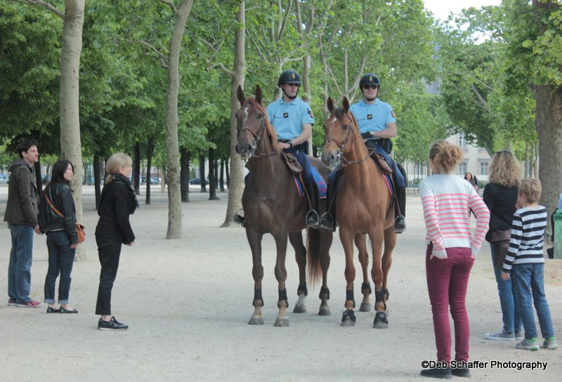 Police talking with visitors to the Eiffel Tower